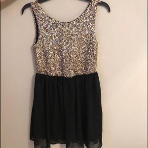 Black and Gold sequined party dress.